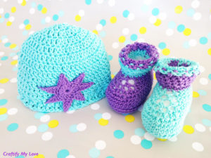 Image shows crocheted newborn booties and hat that are very cute and easy to make.