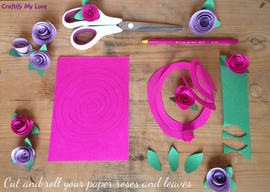 This image shows how to make paper roses - step 1: Cut our a spiral and roll it tightly. Also cut out the leaves.