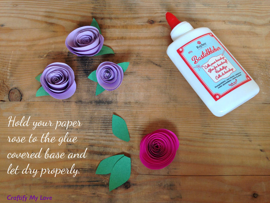 This image shows how to make paper roses - step 3: press the rose carefully on the glue and let dry properly.