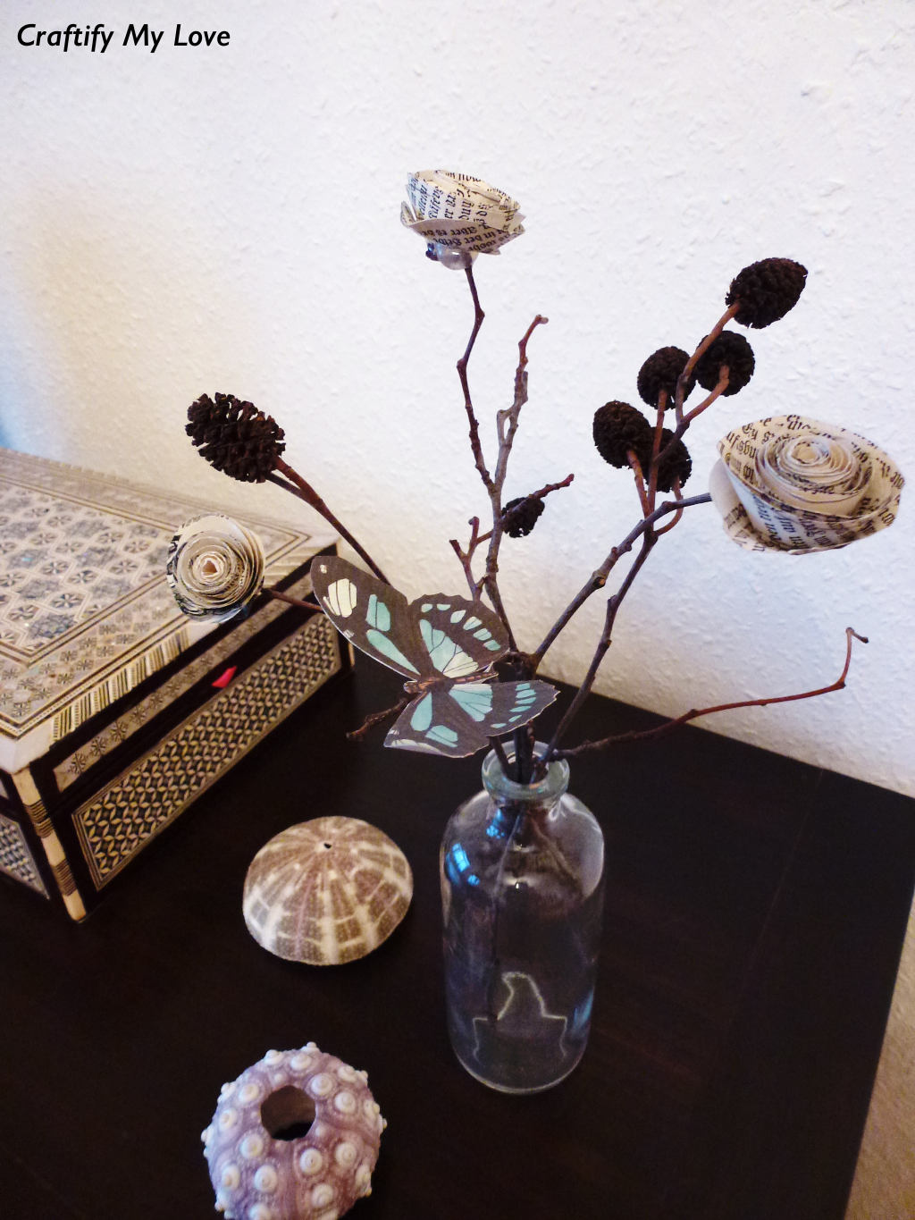 This image shows an ever blooming diy paper rose bush made out of old book pages