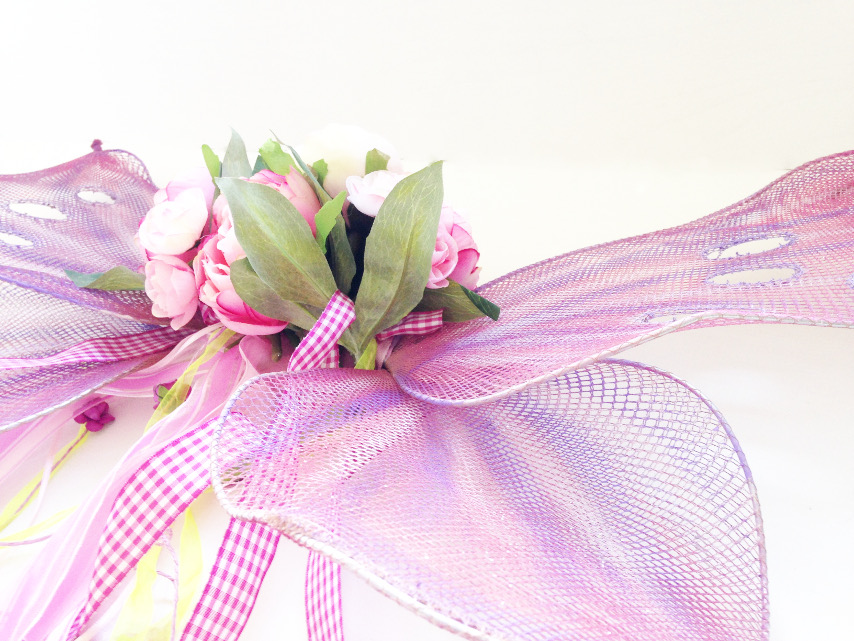 close up of handmade butterfly or fairy wings in pink, lavender and sparkle