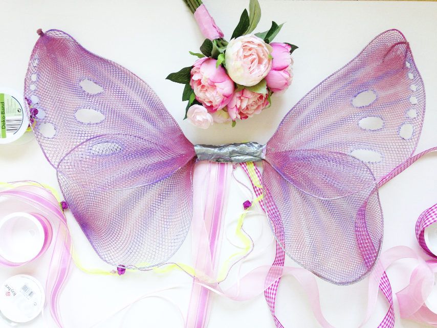 decorating handmade butterfly or fairy wings with ribbon and silk flowers