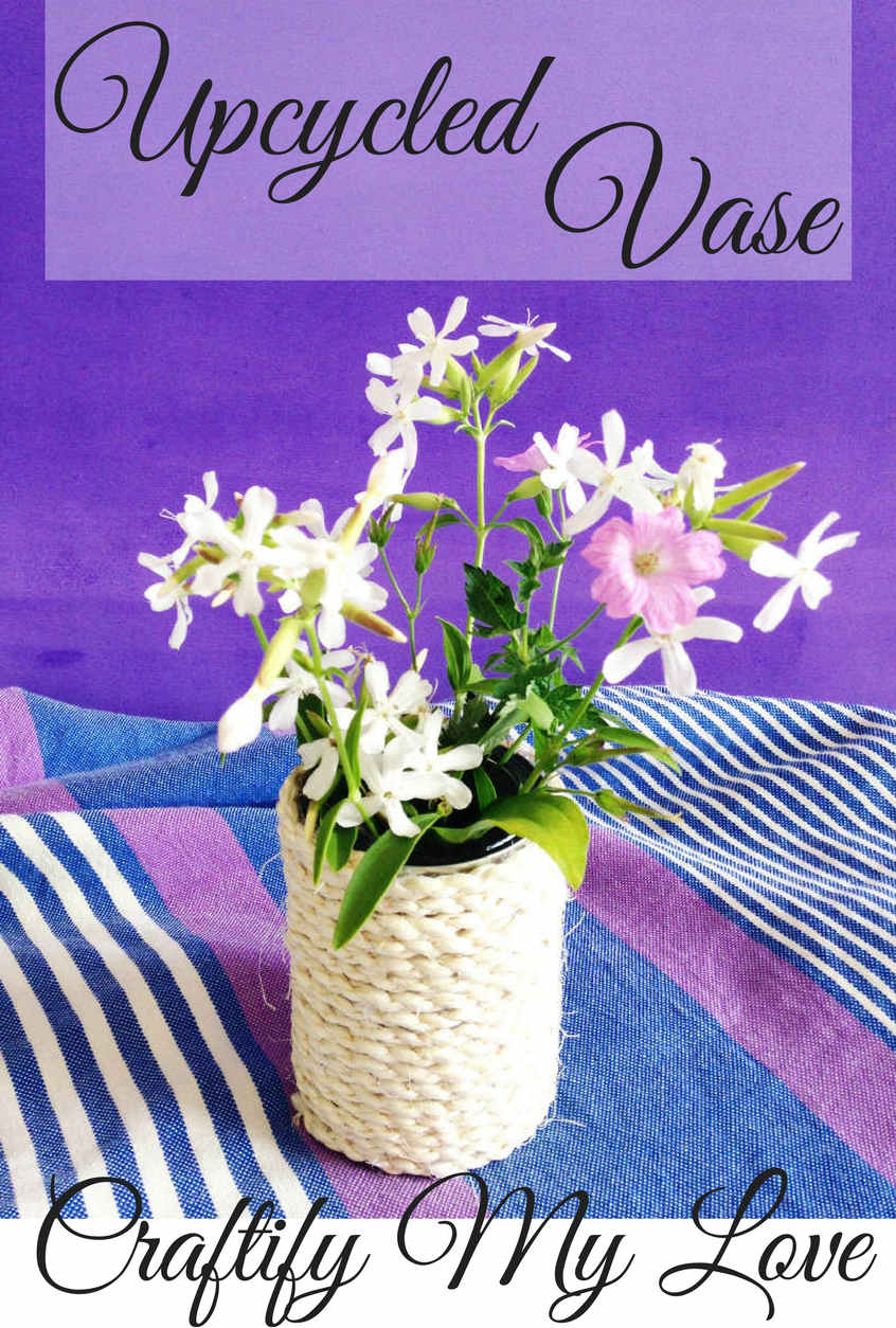 DIY upcycled vase using a tin can and rope