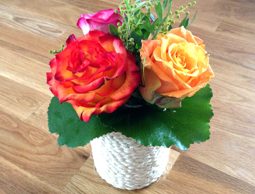 center piece with roses in an upcycled rope vase.