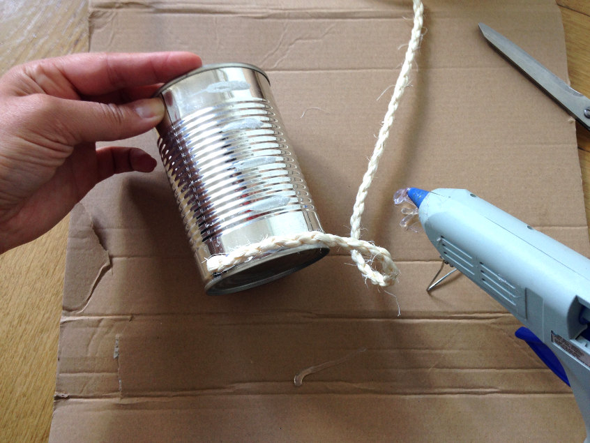 glue the beginning of your rope to the can to get started with your upcycled rope vase