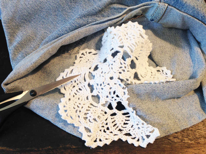 After sewing lace in place, cutting off excess material.