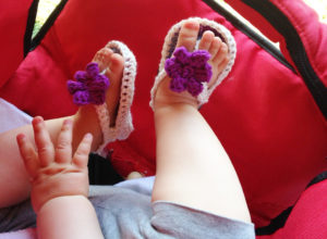 handmade crocheted baby flip flops with a flower