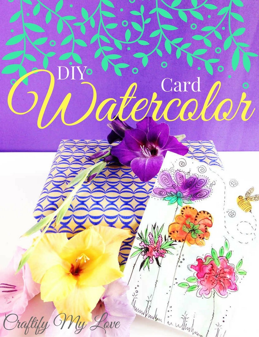 Click to learn how to DIY a watercolor card with handprinted flowers.