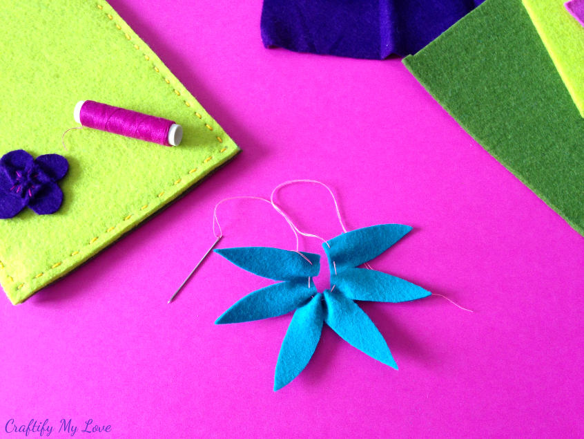 forming felt flower clematis by pulling on thread