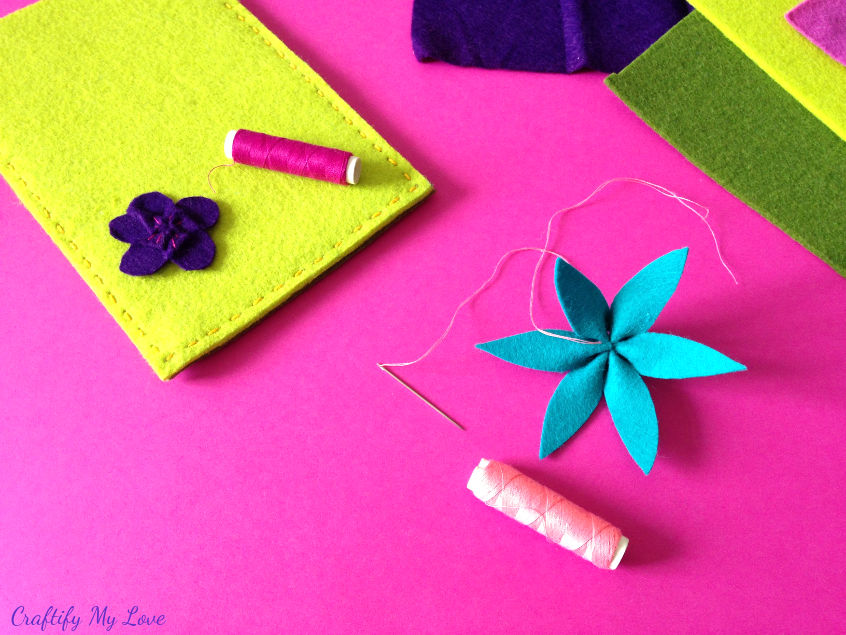 knot the thread to secure felt flower clematis and start stitching details to flower