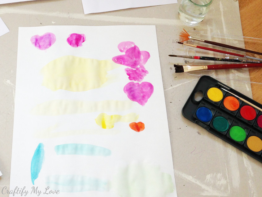 supplies needed for watercolor cards are watercolor, brushes, water and paper