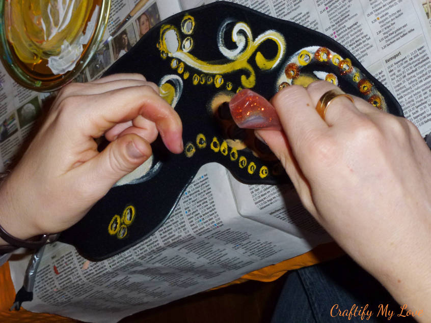 decorating pantyhose wing for butterfly costume with lots of glitter