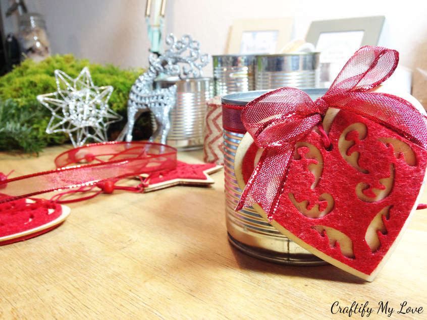adding Christmas ornaments to upcycled tin can advent wreath
