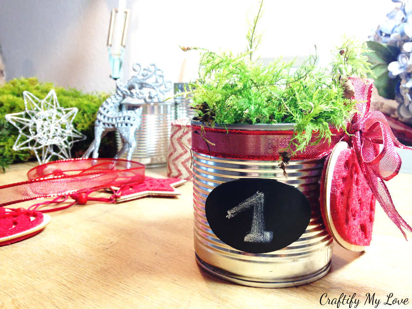 sticking chalk board sticker to recycled tin can advent decoration