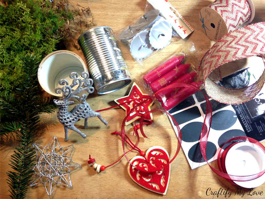 Supplies for a recycling craft project using old cans for a DIY Christmas decoration