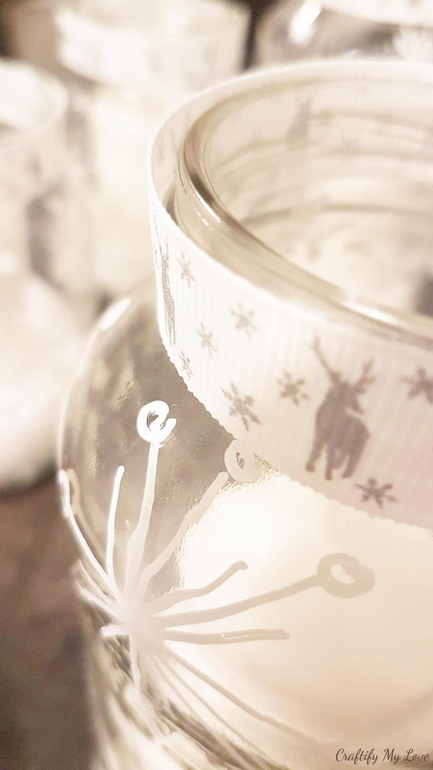 Upcycling jam jars into Christmas candle holders