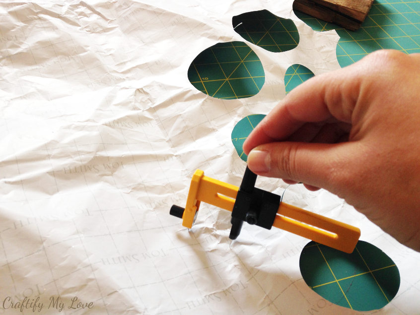 Cutting wrapping paper circles with a compass circle cutter