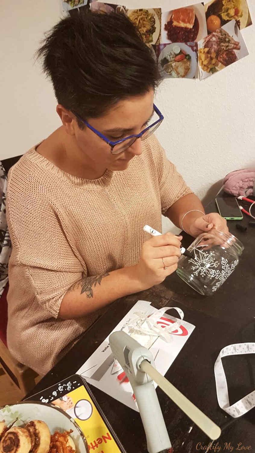 hand painting snowflakes on recycled jars candle holder
