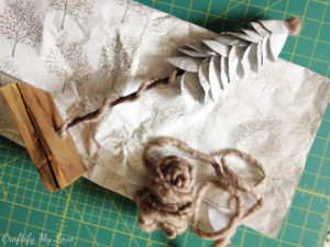 Materials needed for upcycled grift wrap paper Christmas decoration