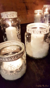 snowflake painted recycled jam jars candle holder