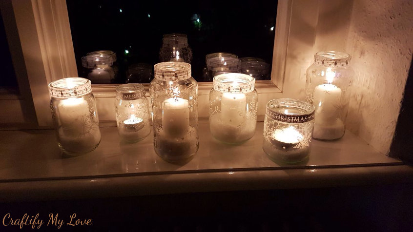 snowflake sharpie painted jars turned into candle holders