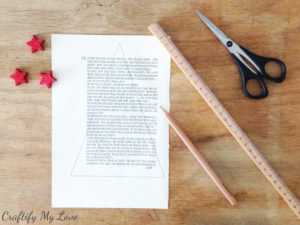 draw a triangle on a vintage book page to start your paper Christmas tree