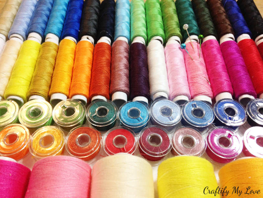 colourful DIY sewing or craft room decor recycling bobbins