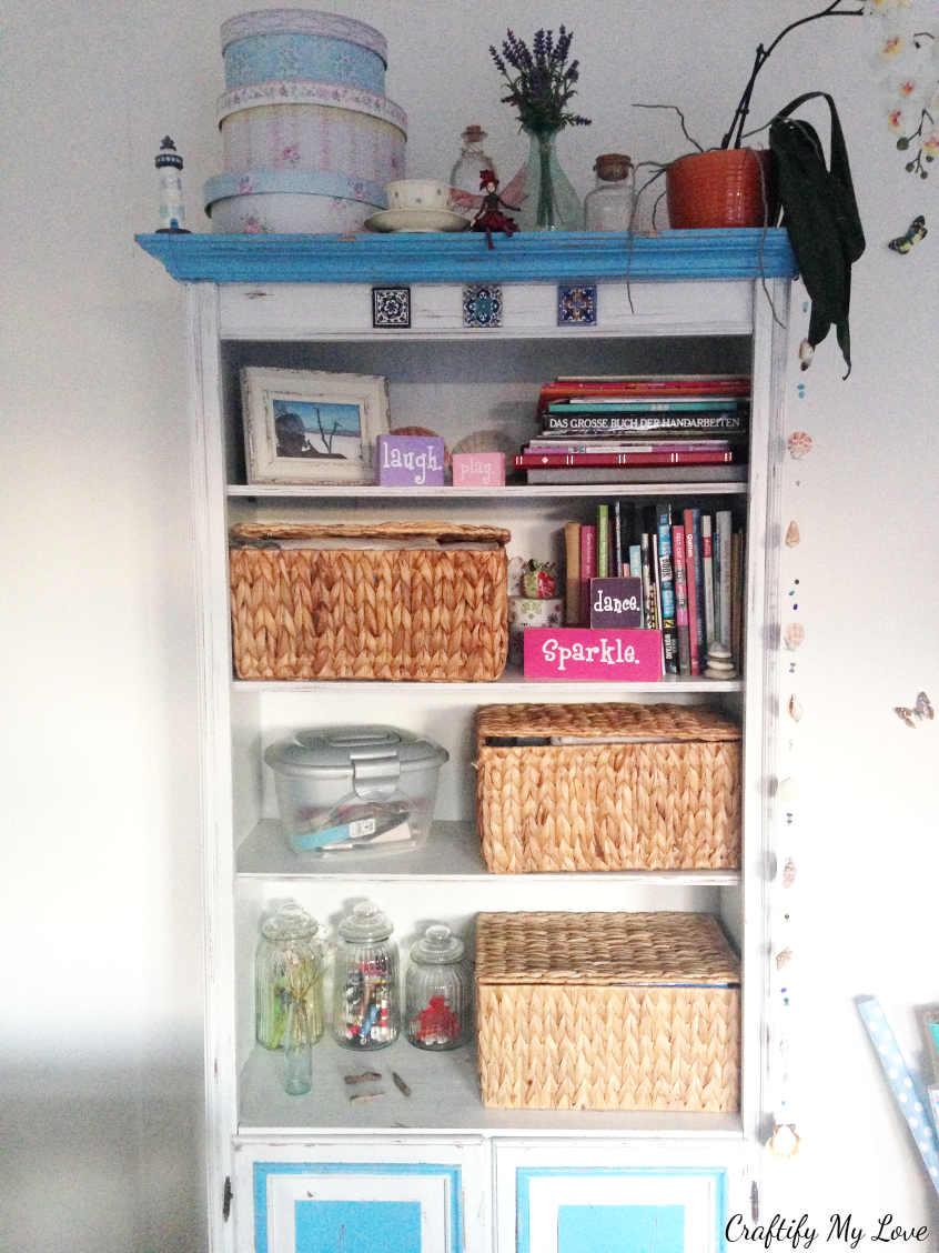 decluttered bookshelf after purging for the craft room challenge