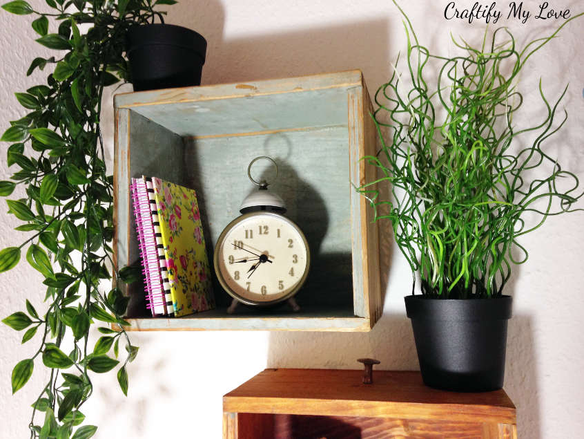 hanging drawers that hold a clock for craft room remake