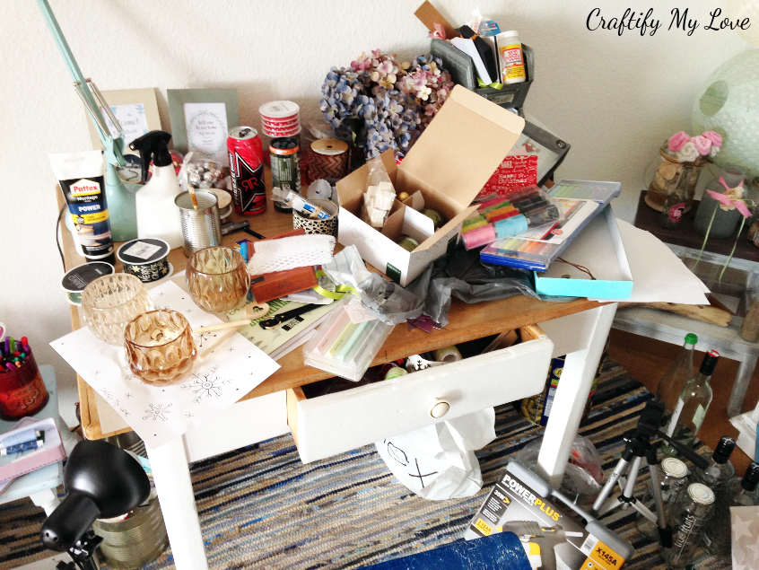 Messy work space of a desk that needs to be tackled in the craft room challenge 2018