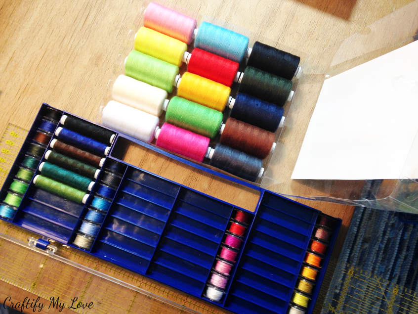 recycling project for thread spools and bobbins into a sewing room decor wall art