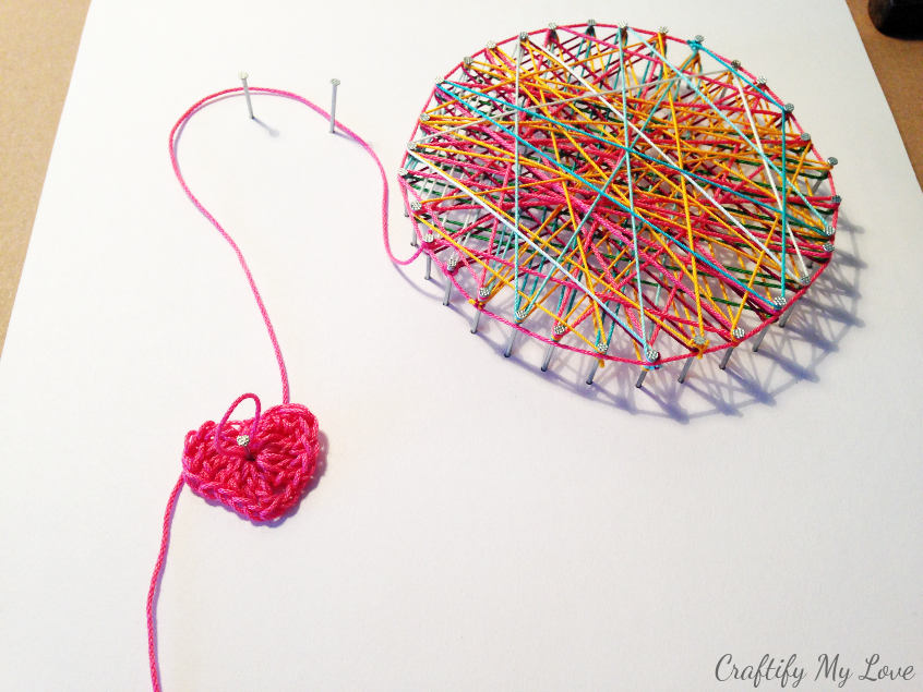 crocheted heart string art ball of yarn wall art for craft room