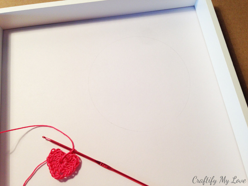 decide on string art design and create a composition