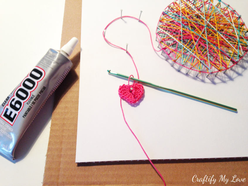 gluing crocheting hook into place using E6000 crocheting inspired string art