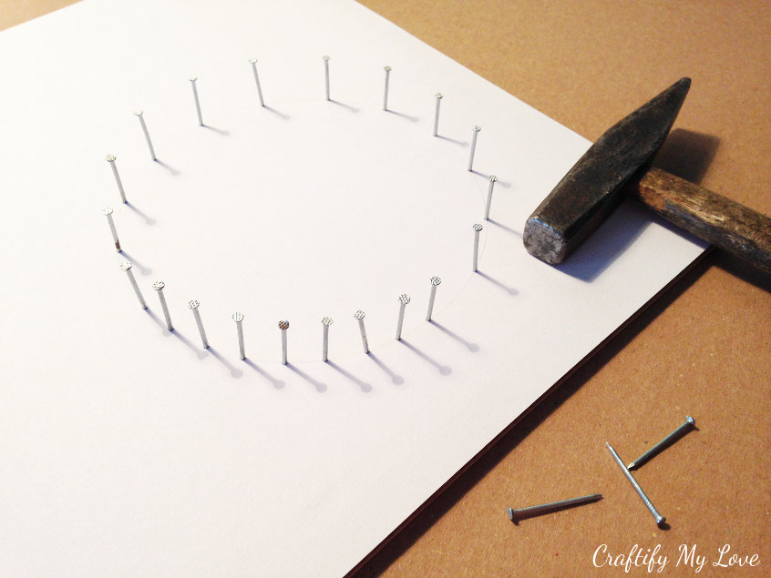 hammer down nails along trace line for string art