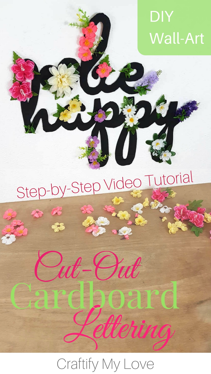 Ready for SPRING or a little MOTIVATION? Learn how to make this recycled cardboard cut-out sign today! Click for Step-by-Step Instructions including Video Tutorial | #behappy #motivationalquote #cardboard #recycling #upcycling #DIY #craftsproject #chalkpaint #silkflowers #dollartree