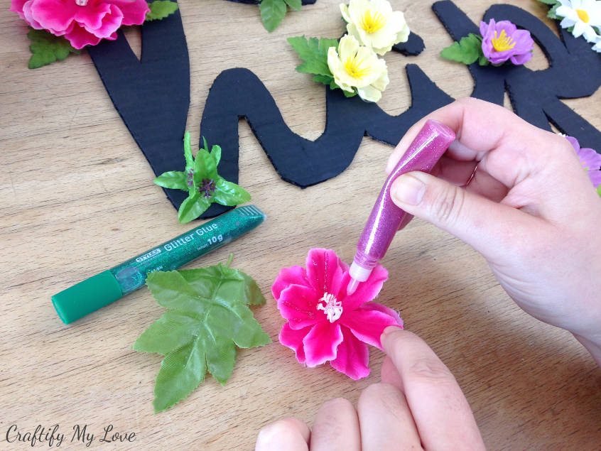 adding sparkly glitter glue to spring craft project