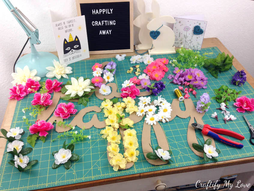 arrange flowers on your motivational cut-out cardboard sign until you're happy with the design