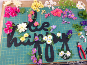 arrange the silk flowers on your motivational sign