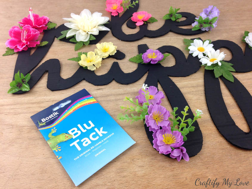 blutack is a removable adhesive that is ideal for sticking your motivational sign to the wall