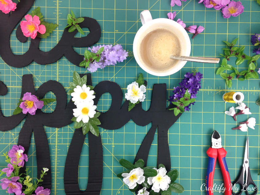 coffee break during a diy crafts project to make an upcycled motivational be happy cardboard cut-out sign