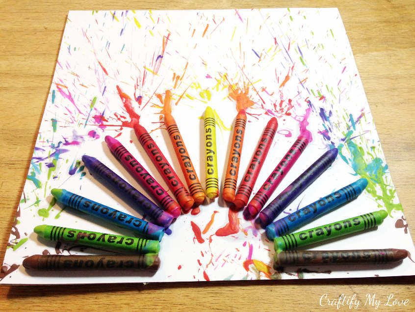 gluing crayons on cardstock for rainbow fireworks. Paint splatter inspired home decor