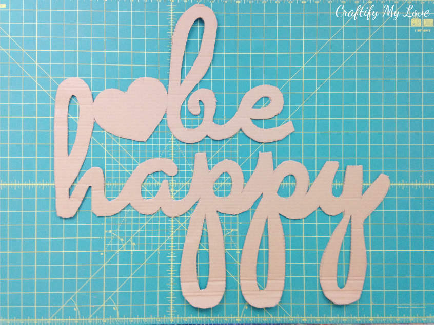 this cardboard cut-out will be the base for your hand painted be happy motivational wall art