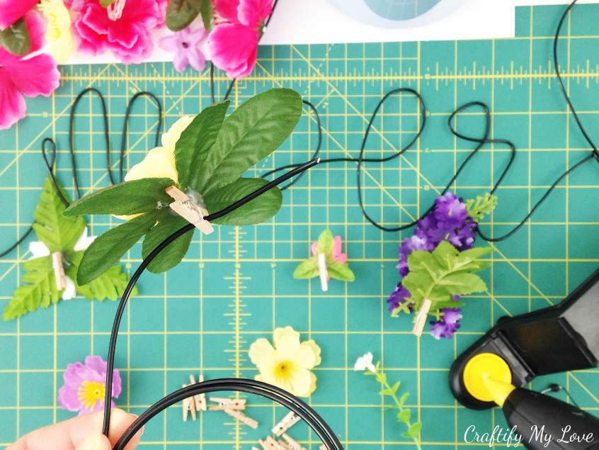 simply clip handmade floral photo pin or peg to wire grid board