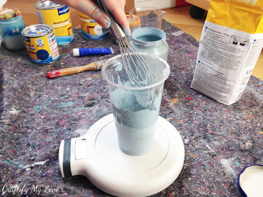 stir acrylic or latex paint into plaster of paris water mix for homemade chalk paint