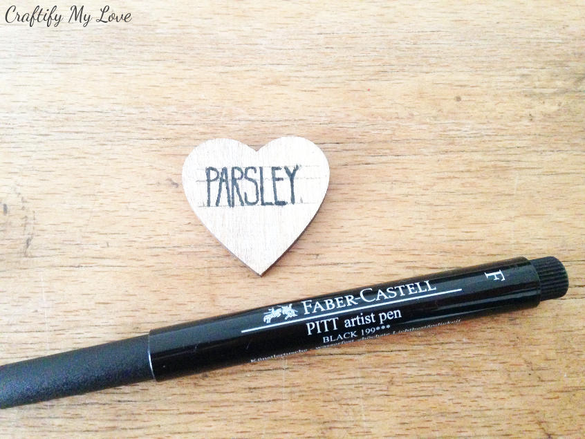 adding the herb name to your heart shaped DIY plan marker with an artist pen size F