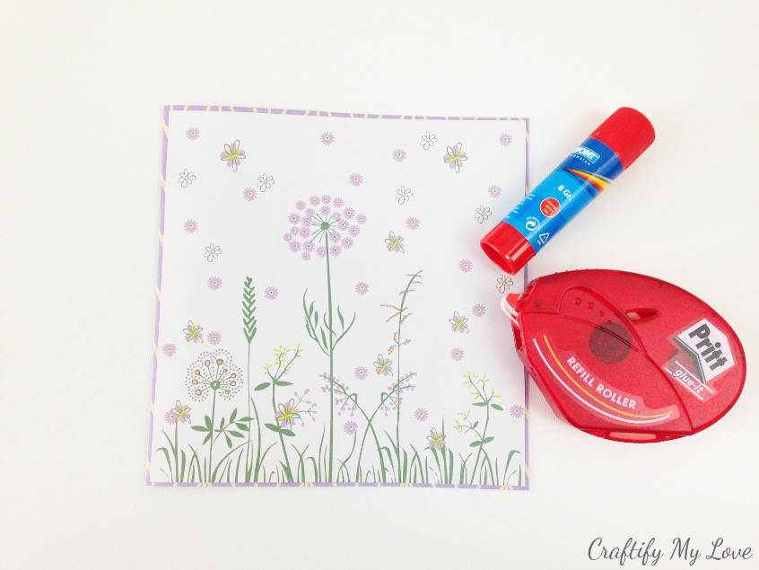 layering paper with glue stick for DIY floral birthday card