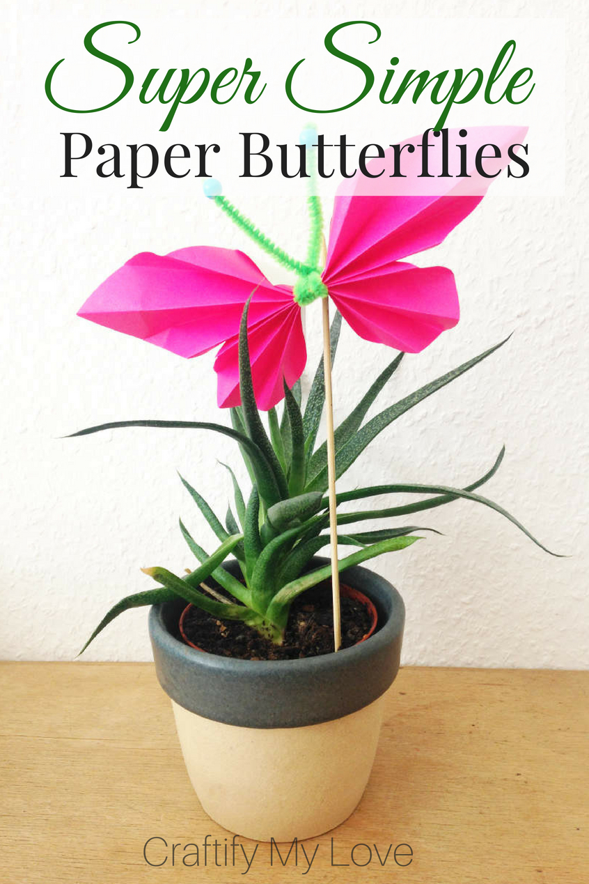 Quick and easy kids craft!!! Accordion fold paper butterfly that can be a plant stick, mobile, gift wrapping element or home decor. #craftifymylove #butterflycraft #plantsticks #kidscraft #papercraft #summeractivity
