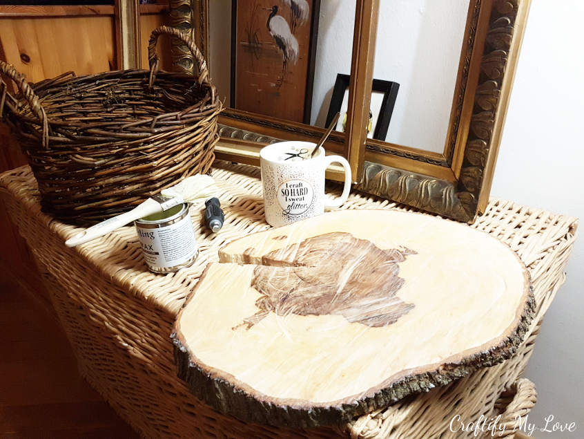 apply an even coat of clear wood wax to sanded tree slice to seal the surface and let it dry