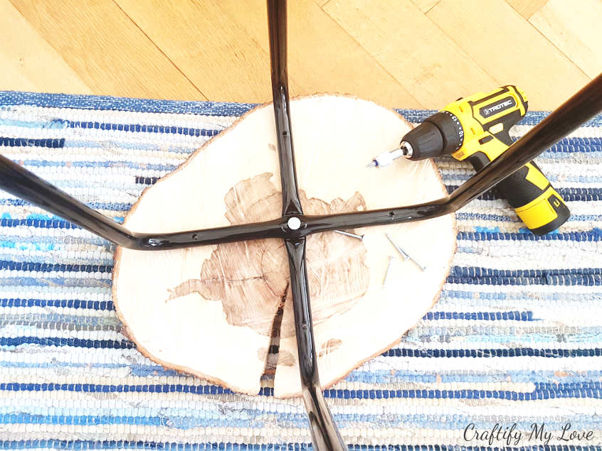 position IKEA Marius legs on wood slice and mark the holes before drilling
